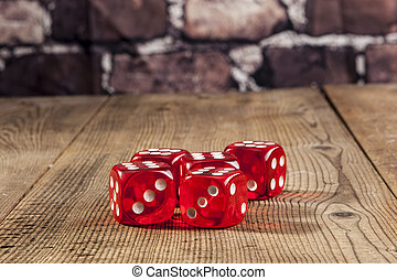 Pice of Dice - Red dice rolling on brown wood table