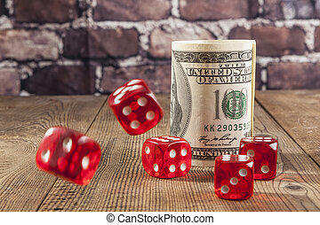 Red Dice And Green Dollar - Rollin dice and cash on brown...