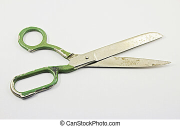 Old large pair of scissors on a white background