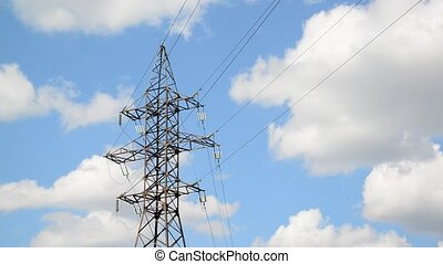 High-voltage power line on sky background