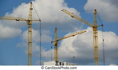 Construction cranes against sky, timelapse - Construction...