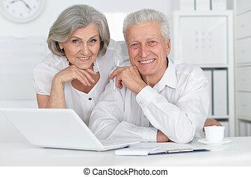 Senior couple with laptop - Portrait of a senior couple...