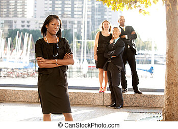 Business Team Woman - An African American woman in front of...