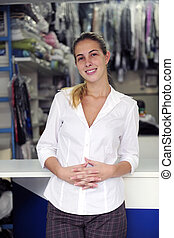 happy owner of a dry cleaning business - small business:...
