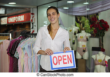 retail business: store owner with open sign - retail...