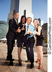 Business Thumbs Up - A group of business people giving a...