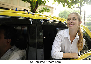 happy female passenger inside of a taxi - urban transport:...
