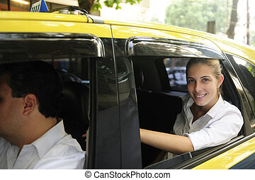 happy female passenger inside of a taxi