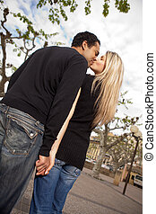 City Couple Kiss - A couple in an urban European city...