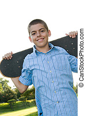 Teenager with His Skateboard - A boy in his early teens...