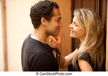 Couple Flirt Kiss - A couple flirting on a quaint street in...