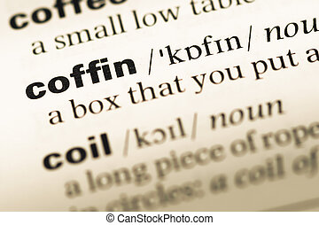 Close up of old English dictionary page with word coffin