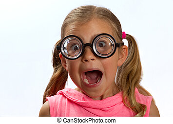 Little girl wearing big round glasses and making a silly...