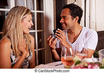 Give Ring Gift - A man giving a ring as a gift to a female...