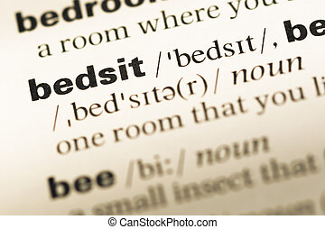 Close up of old English dictionary page with word bedsit