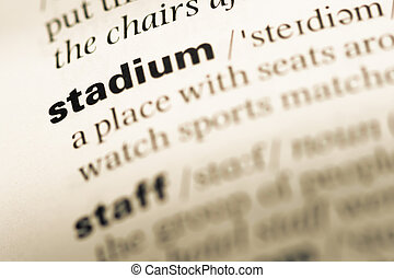 Close up of old English dictionary page with word stadium