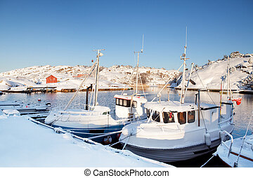 Winter Snow Boat - A dock in southern Norway with boats...