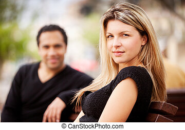Happy French Woman - A french couple sitting on a city park...