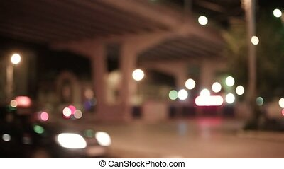 Overpass and cars. Cityscape from ground at night slow...