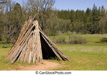 Umacha or dwelling of the Sierra Miwok tribe in California -...