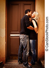 Kiss Europe Street - A couple kissing in an urban European...