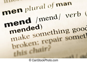 Close up of old English dictionary page with word mend