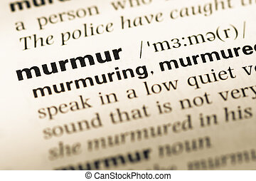 Close up of old English dictionary page with word murmur