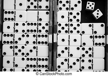 Dominoes - Closeup of a dominoes laying on a flat surface.