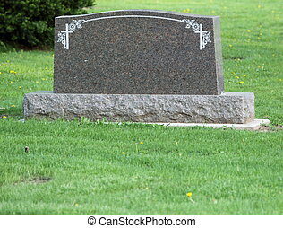Blank headstone in cemetery - A blank headstone in a...