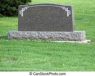 Blank headstone in cemetery - A blank headstone in a...