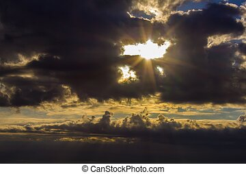clouds and the sun breaks through