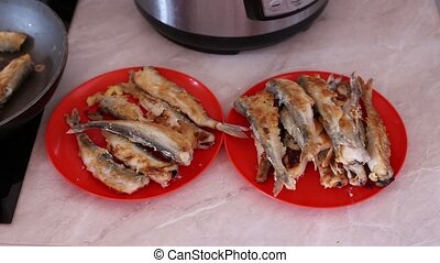 Fried Smelt Fish on plates