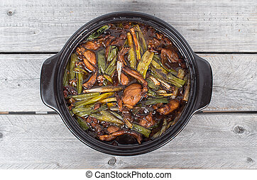Singaporean Claypot Frog Legs with Green Spring Onions on a...
