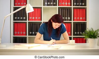 Girl Writing Business Letter In Office