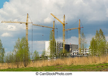 Construction multistorey apartment houses in natural...