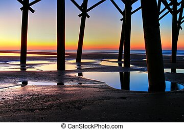 Sunrise Under Folly Pier - Under Folly Beach Pier in...