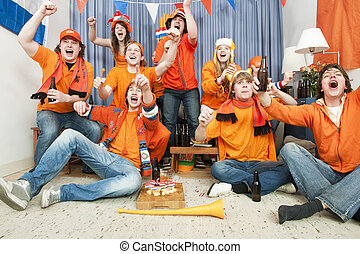Goal! - Cheering fans at home when their national team...