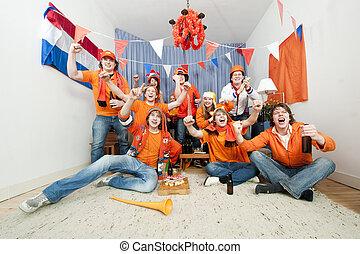 Cheering fans - Group of ten cheering sports fans watching...