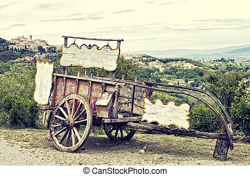 Old wooden cart against vineyards, Tuscany, Italy....