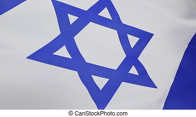 Closeup of Israeli flag moving in the wind