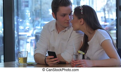 Couple have a date at the cafe - Young couple having a date...