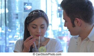Close up of couple kiss each other at the cafe - Close up of...