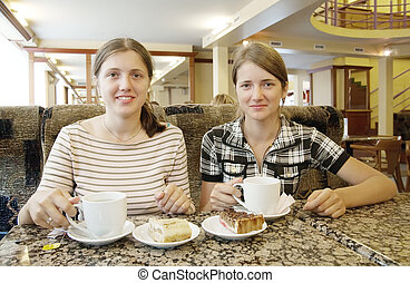Girls  with a cup of tea at coffee-room