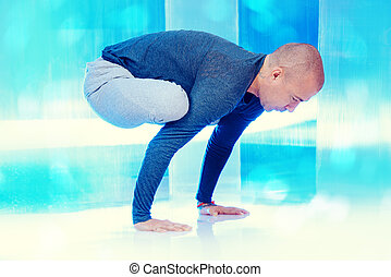 gymnastics - Yoga energy concept Experienced yoga master...