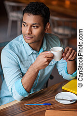 Handsome eastern guy is relaxing in cafe - Cheerful young...