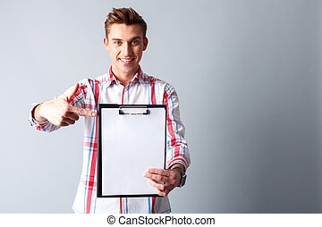 Cheerful guy is presenting file of papers - Waist up...