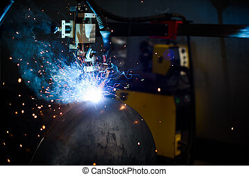 Welding machine and industrial worker on the plant. Close up...