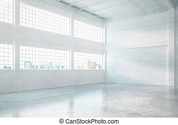 Brick hangar interior - Hangar interior with concrete floor,...
