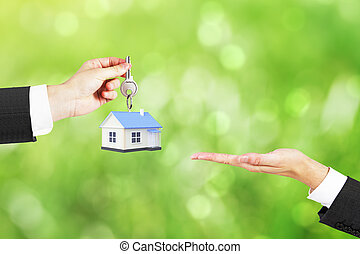 Mortgage concept green background - Mortgage concept with...
