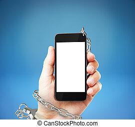 Cellphone cuffed to hand - Smartphone with blank white...